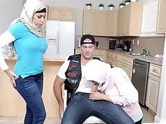 Two Arab women shared on a massive stiff cock on sofa